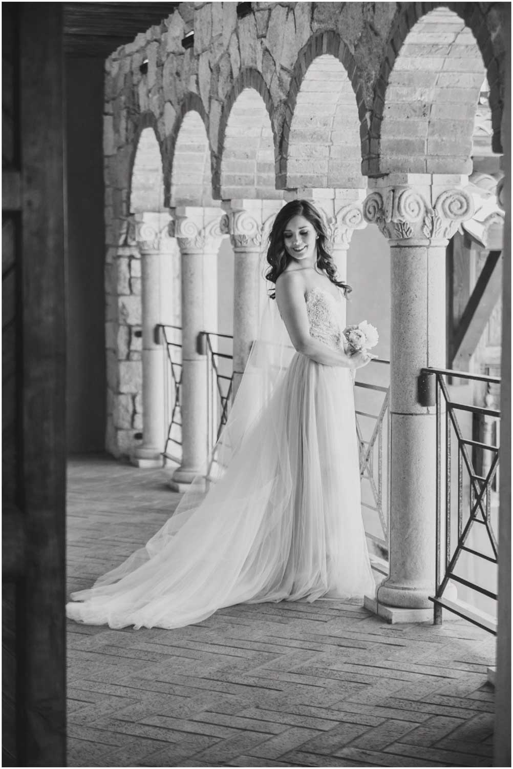 black and white portrait of bride on tuscan style balcony at ranch at the canyons terrebonne oregon