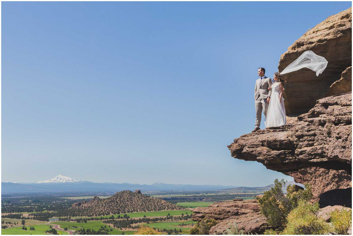 bride and groom adventure portraits at top of misery ridge with monkey face in the background