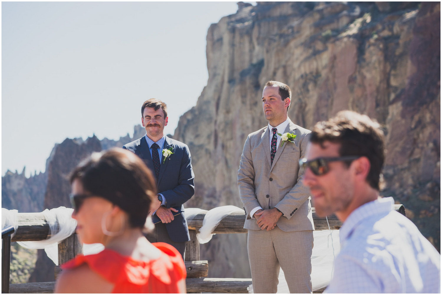 groom watching bride walk to him during wedding ceremony at smith rock terrebonne oregon