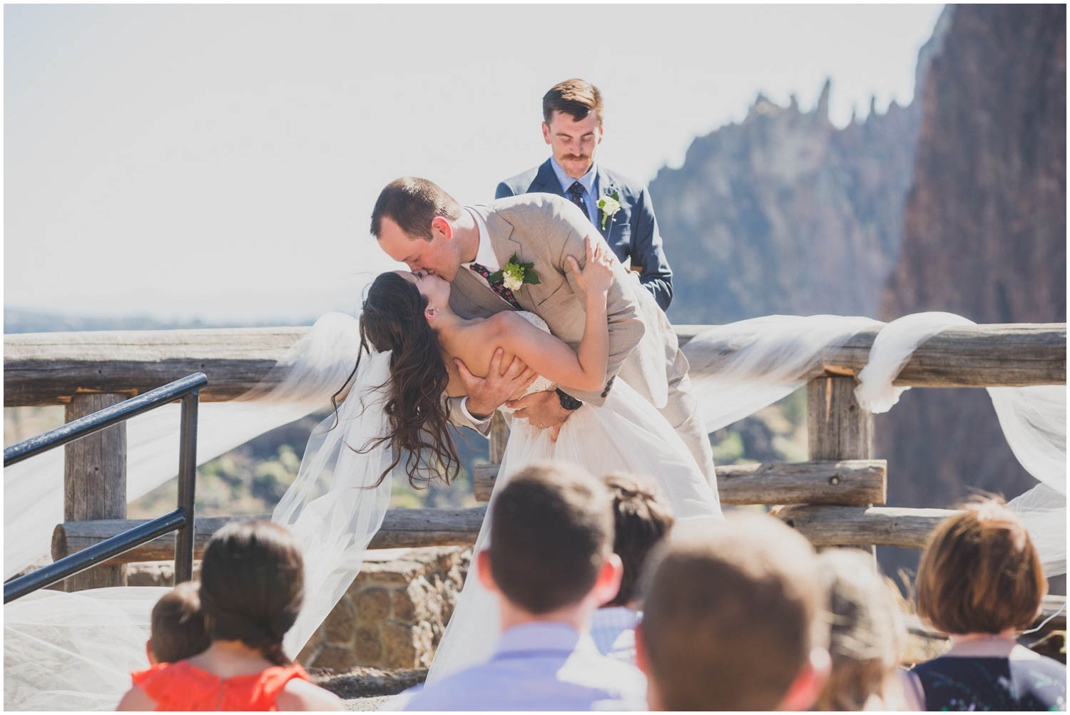 romantic dip kiss at the end of wedding ceremony at smith rock