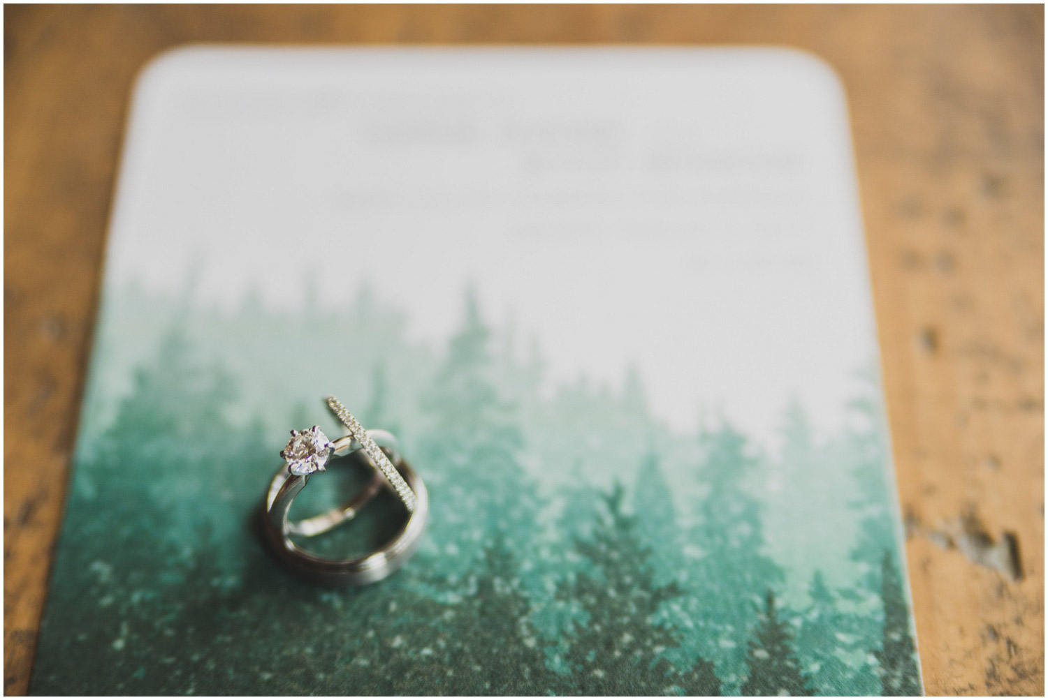 engagement and wedding rings detail with invitation