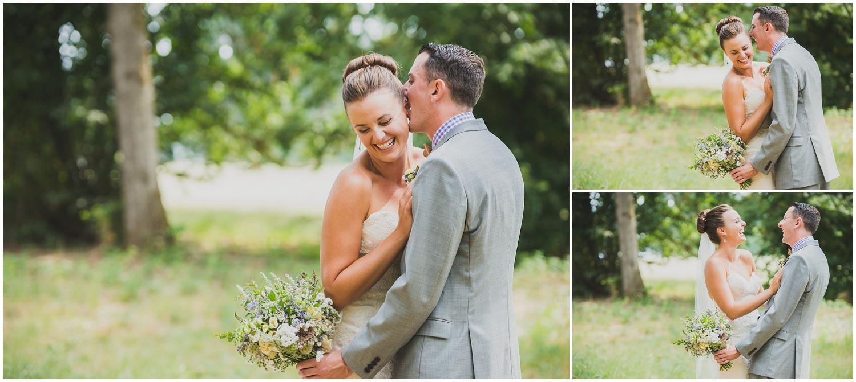 groom whispering sweetly in bride's ear during wedding portraits