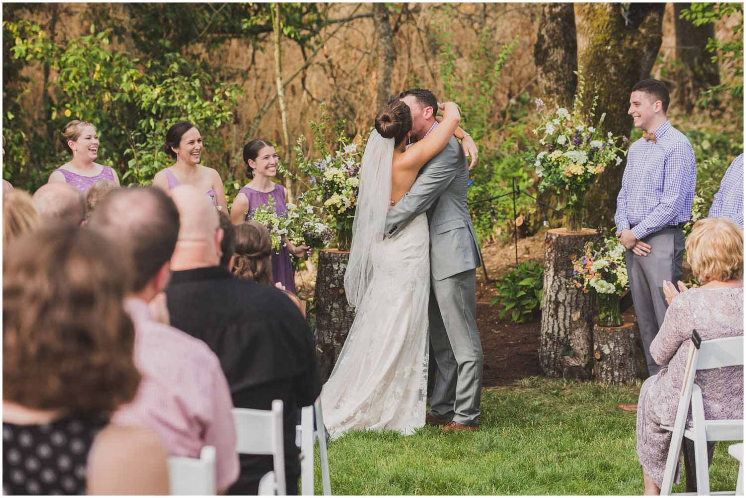 bride and groom first kiss during wedding ceremony eugene oregon