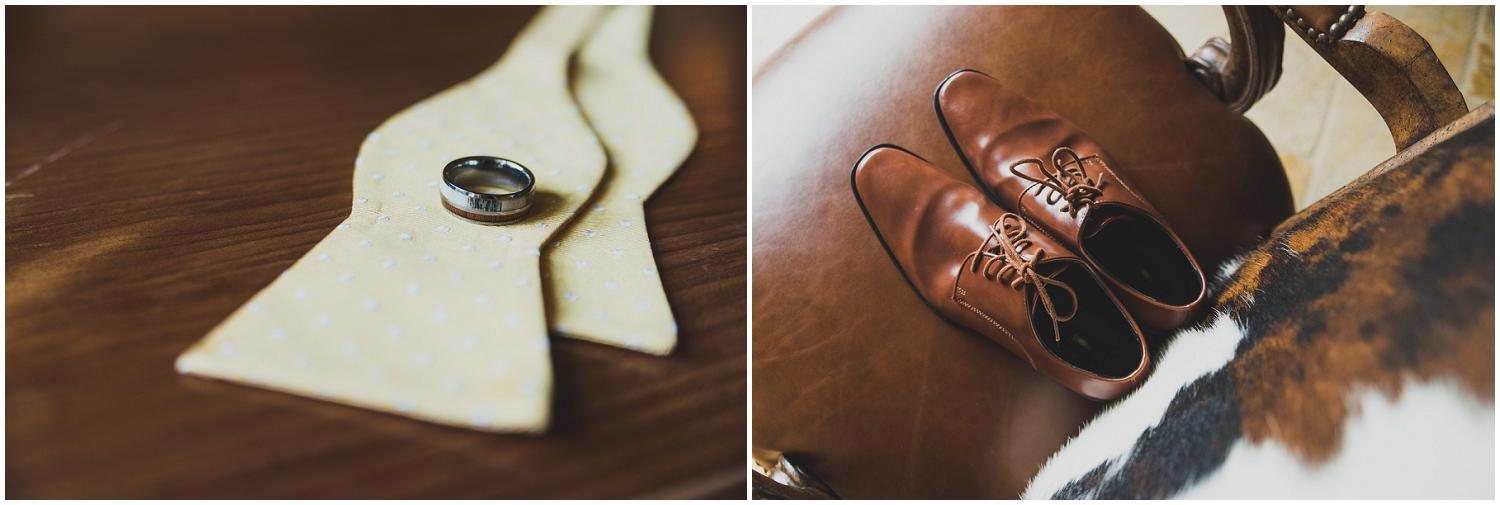 groom's details ring, bow tie, and shoes on cow hide chair