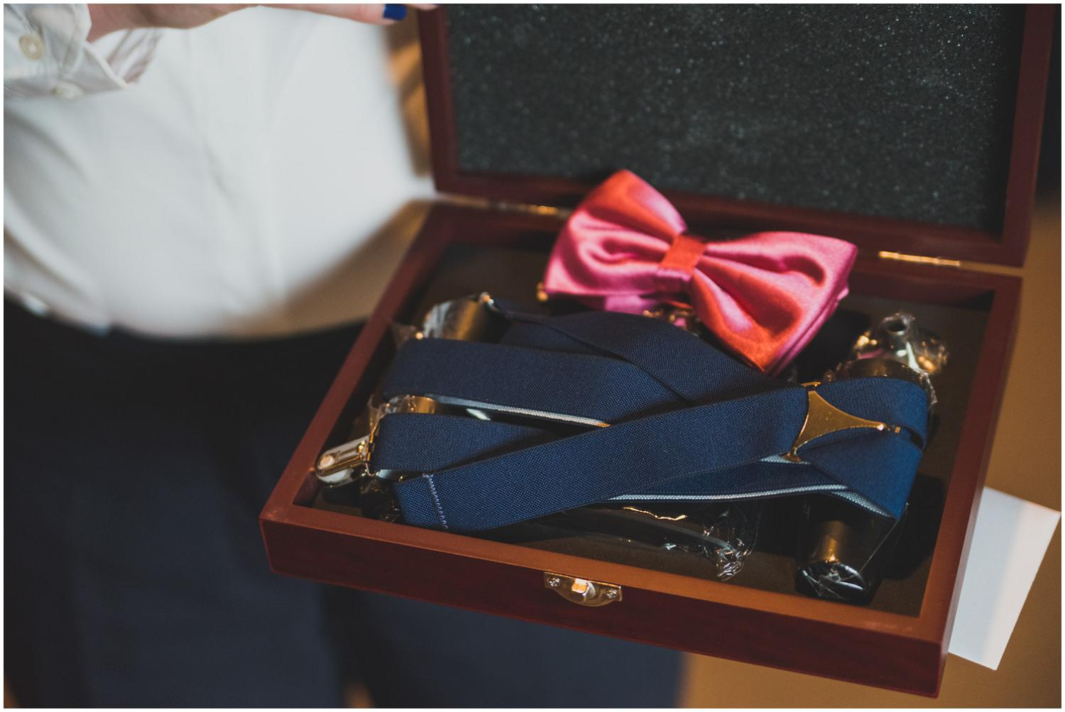 groomsmen gifts: pink bow tie, suspenders, and more in personalized wooden box