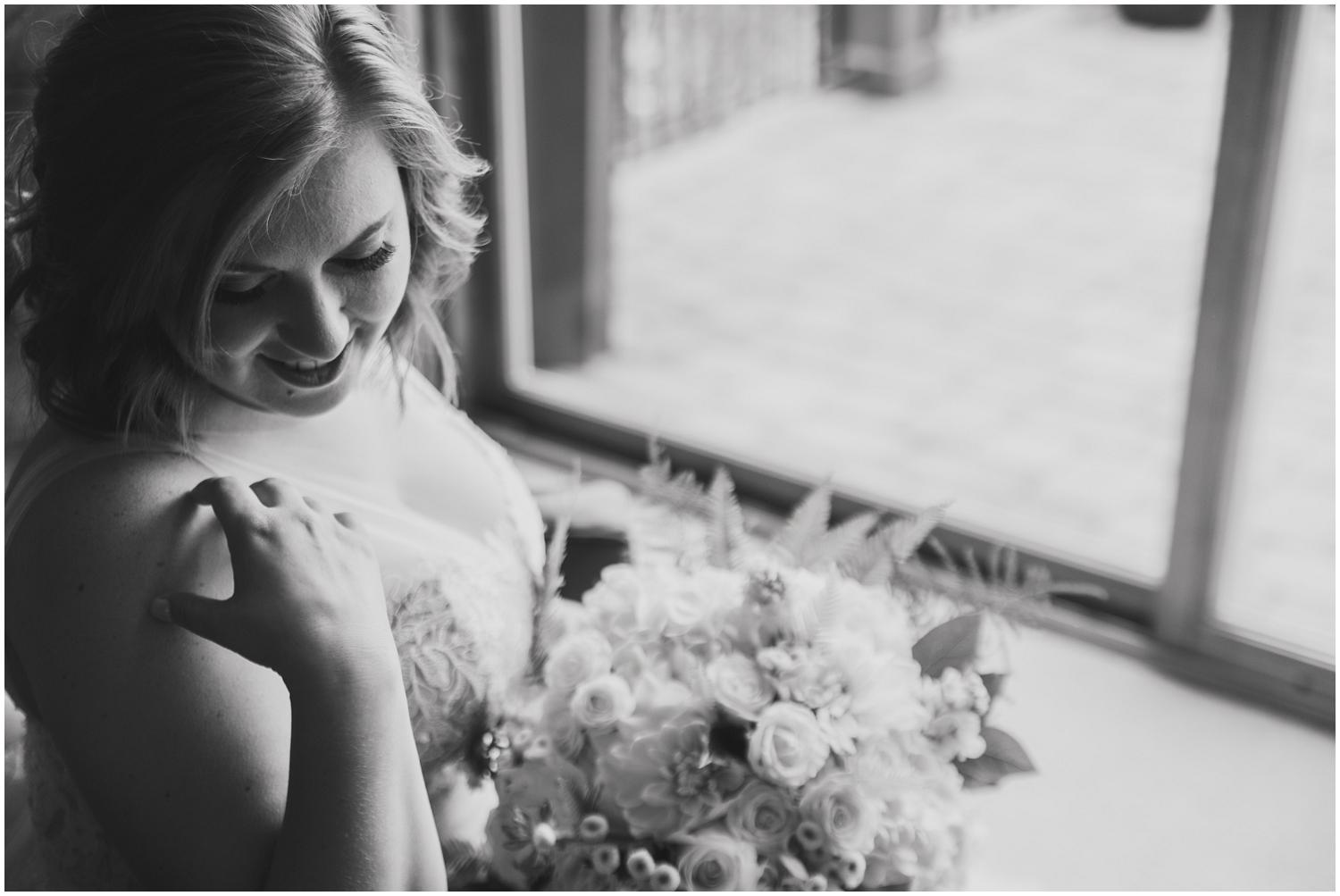 black and white portrait of bride with side window light