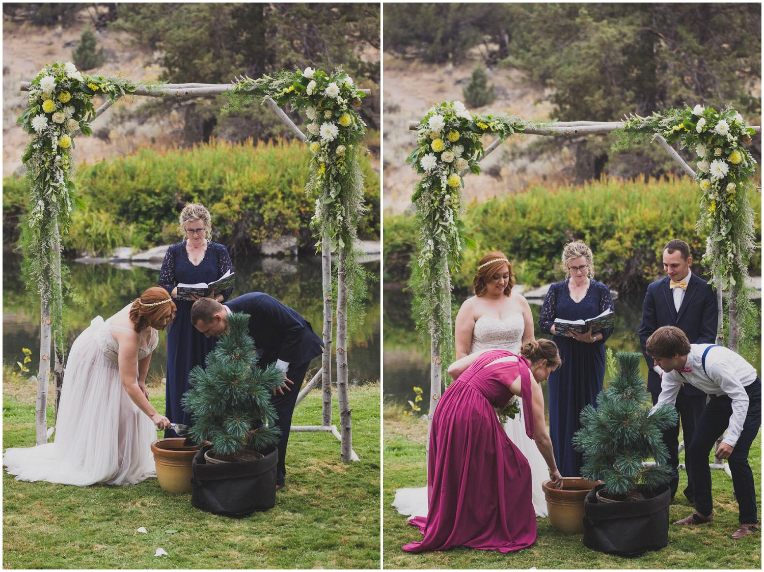 bride and groom add dirt to their unity tree, wedding party also adds dirt to pot