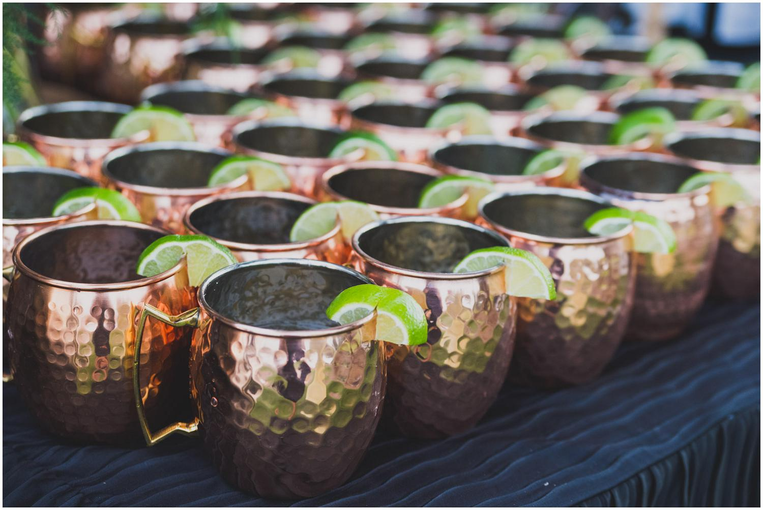copper mugs with limes for reception moscow mules