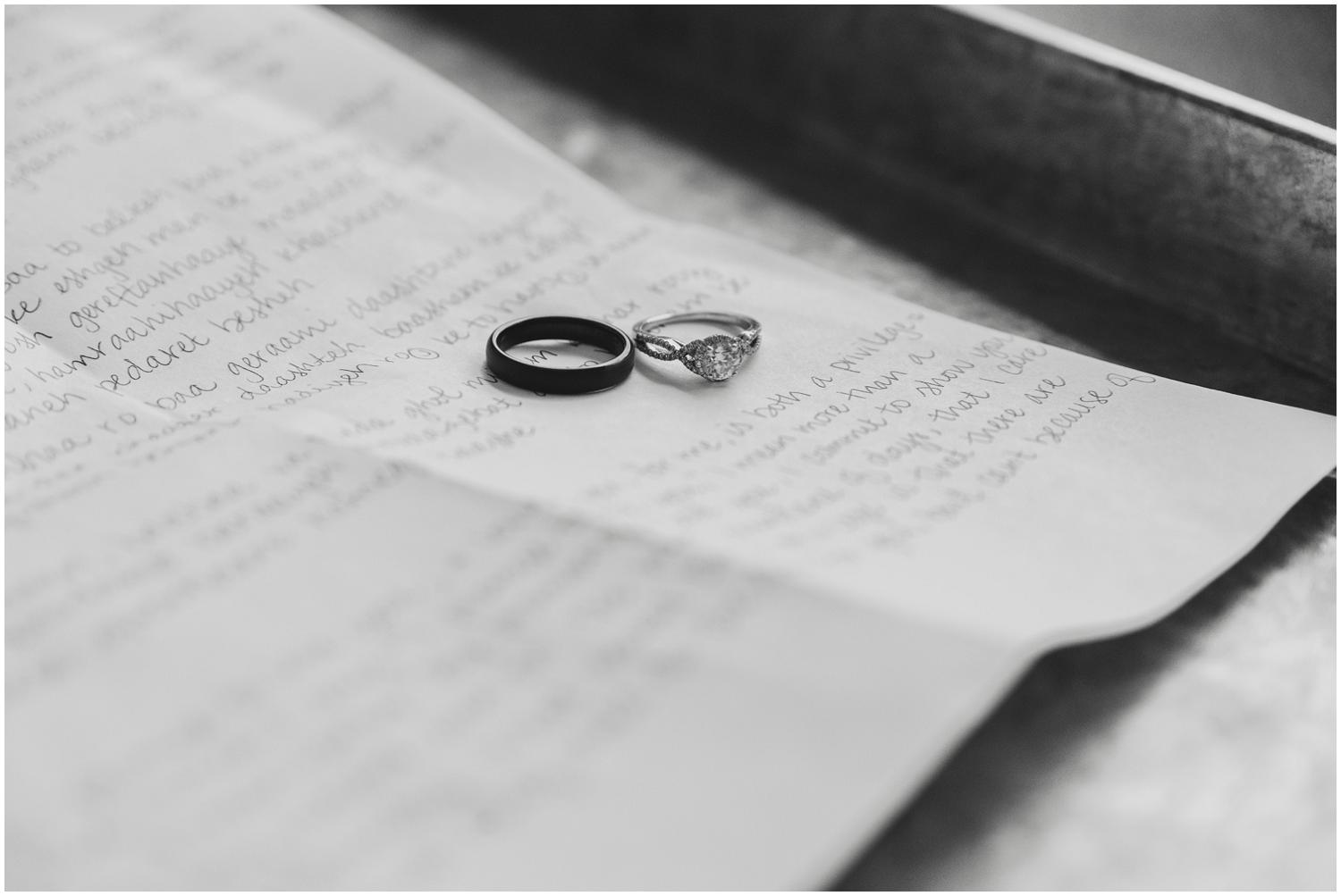 wedding rings with hand written vows in both english and persian