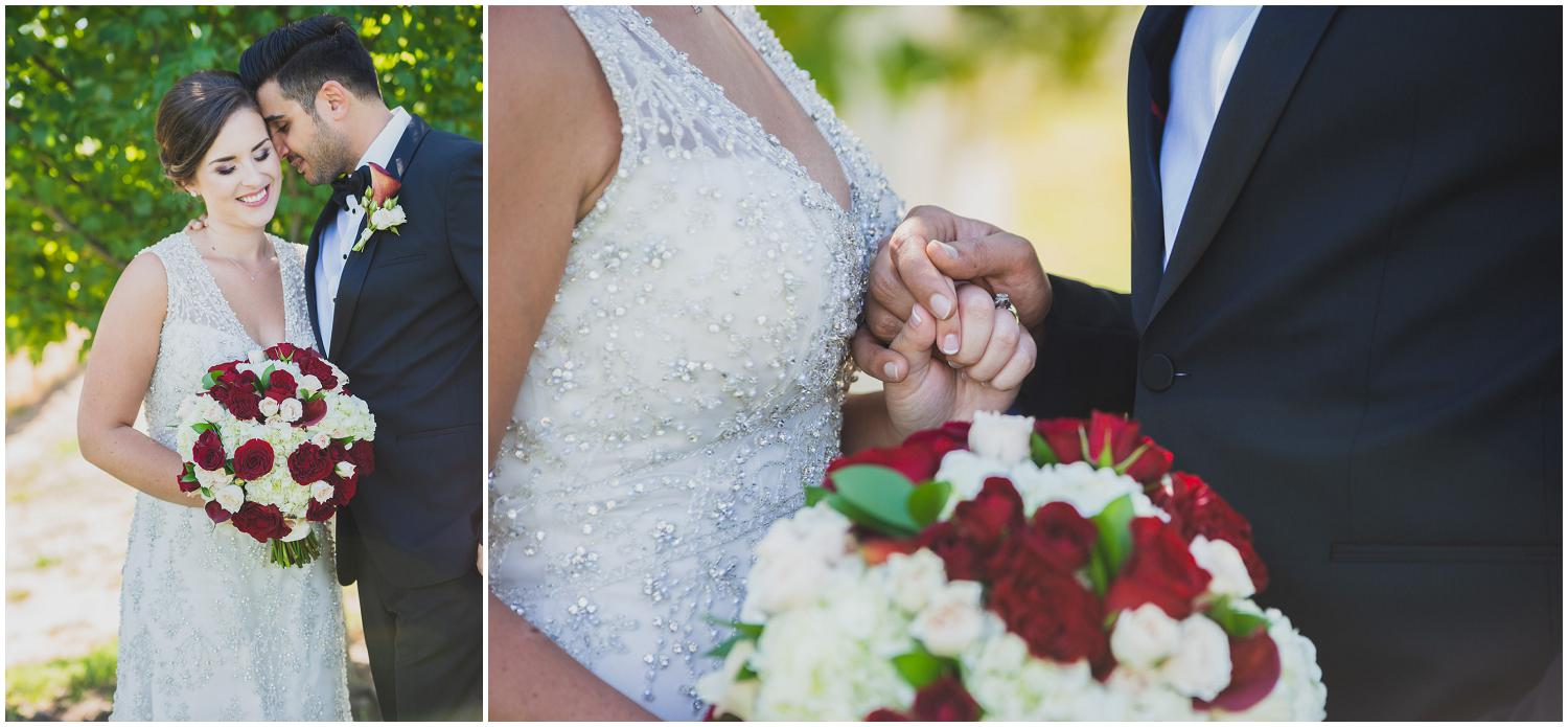 newlyweds snuggling in the shade in classic black tux and white dress with rose bouquet
