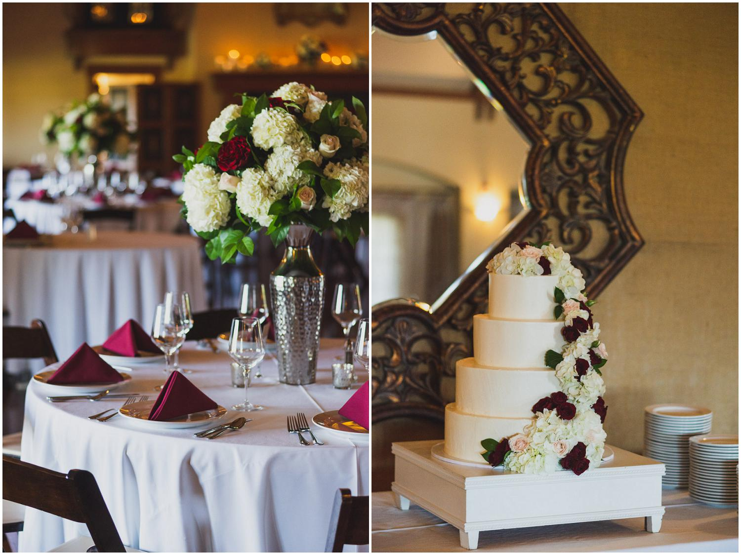 reception dinner tables with statement floral centerpieces and four tiered wedding cake