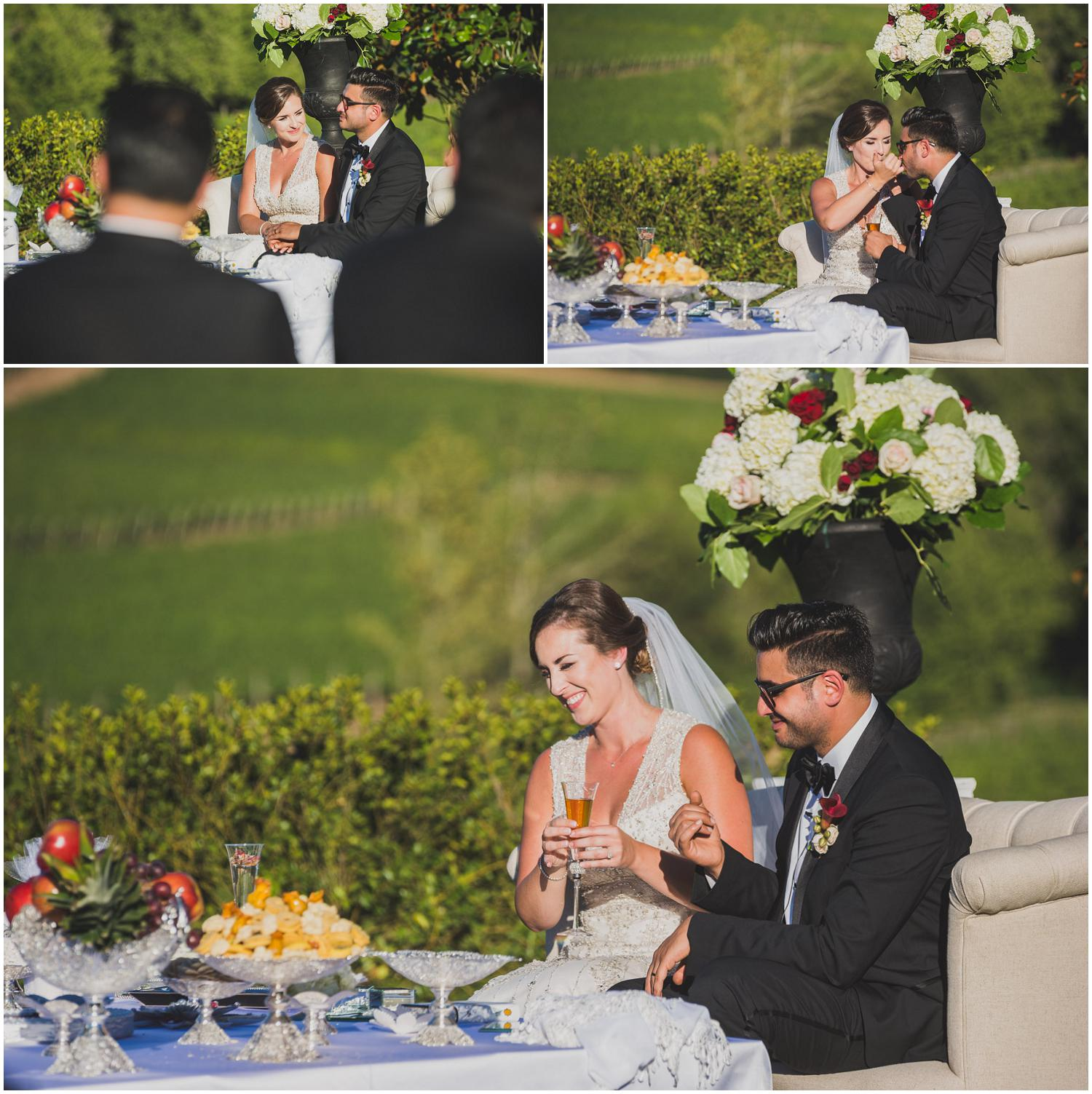 bride and groom eat honey off each other's pinky fingers to symbolize a sweet marriage and life together
