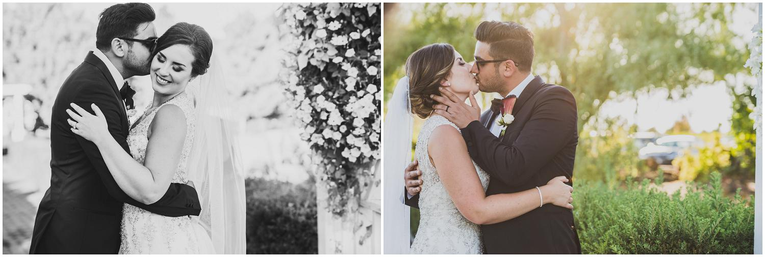 bride and groom sneak a special kiss after their wedding ceremony