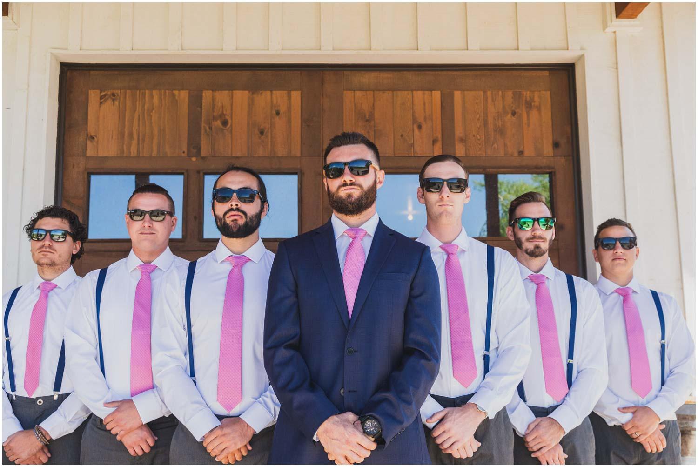 groom with six groomsmen in sunglasses sporting pink ties