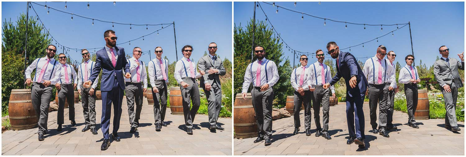 groom in blue suit and pink tie swagger walking with groomsmen down courtyard