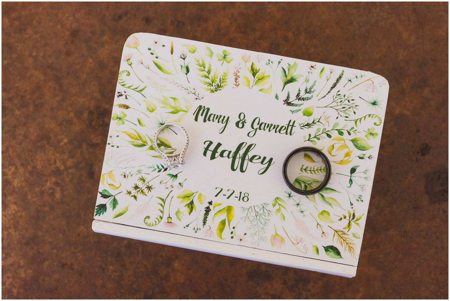floral wedding invitation with engagement ring and band