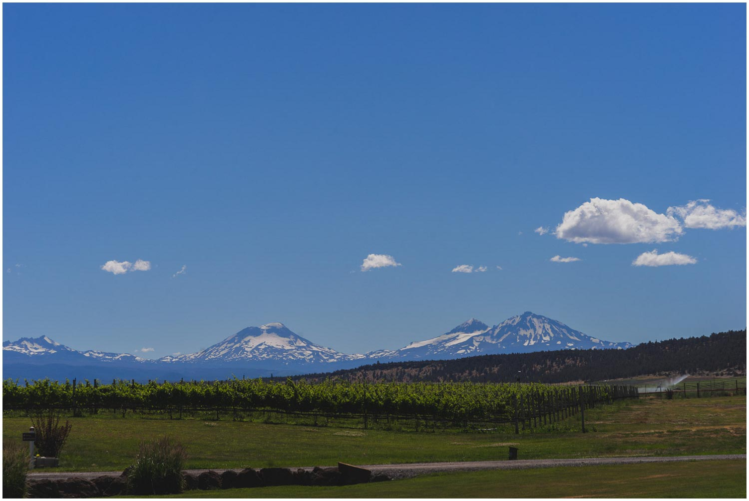 view of three sisters from faith hope and charity vineyard madras oregon