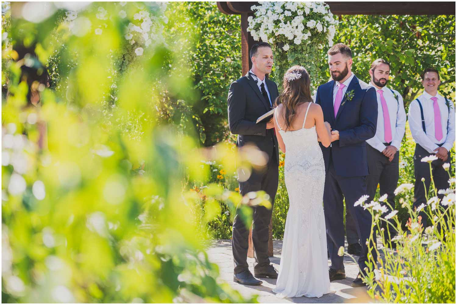 bride and groom repeating their vows during summer wedding at faith hope and charity vineyards