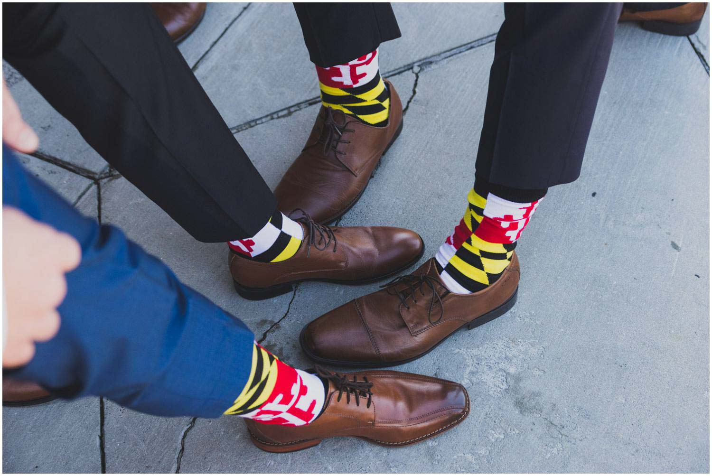 groom and groomsmen showing off fun socks