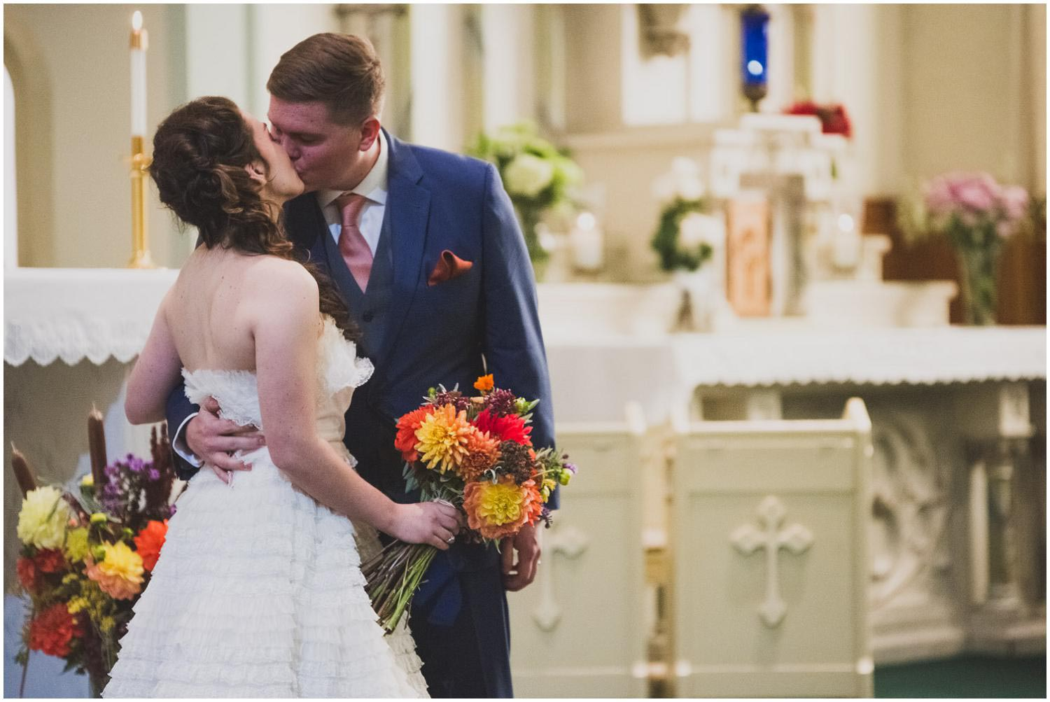 first kiss for bride and groom at the end of their wedding at the historic catholic church in bend oregon