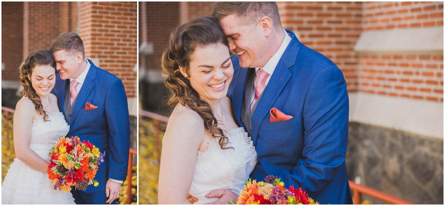 newly wed bride and groom snuggle during portraits outside church