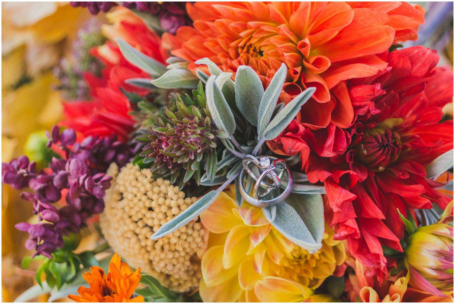 colorful fall bridal bouquet with wedding rings