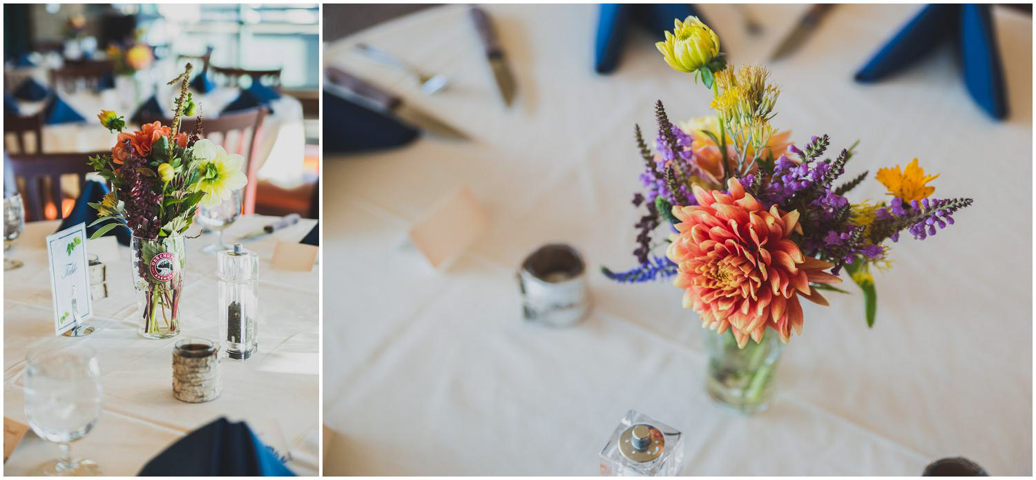 table settings and seasonal flowers at deschutes brewery mountain room for wedding reception