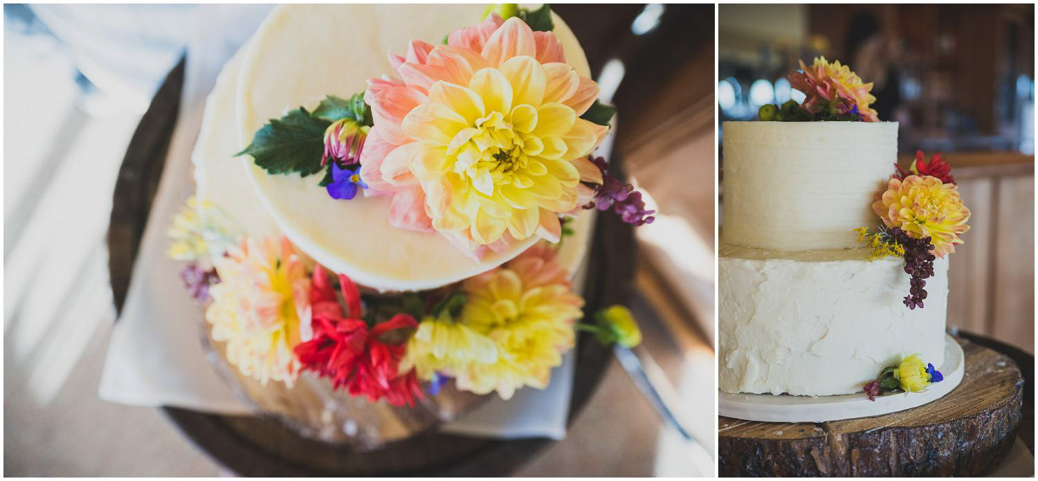 two tiered buttercream wedding cake topped and decorated with seasonal flowers