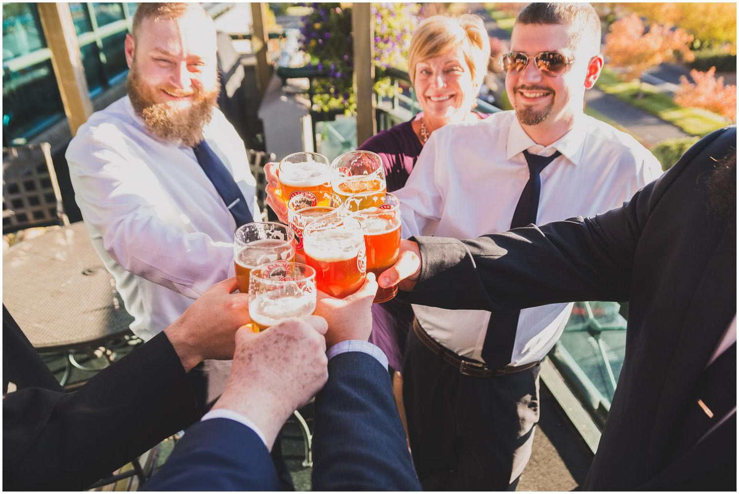 family and guests toasting at wedding reception on deschutes brewery mountain room deck