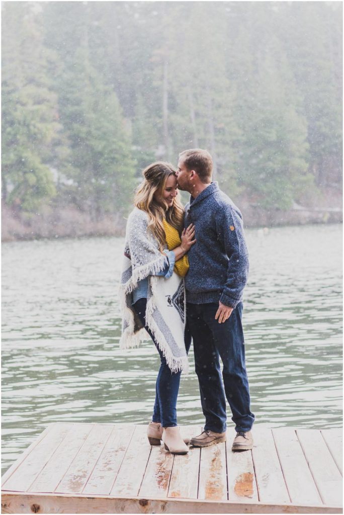 romantic snowy engagement session on the suttle lake dock