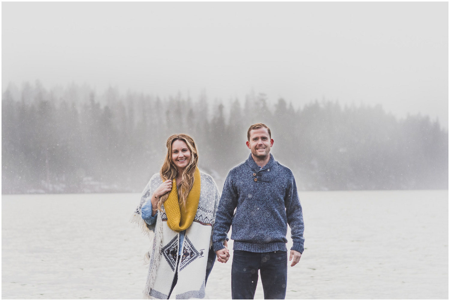 windy snowy drunk weather during lakeside engagement session