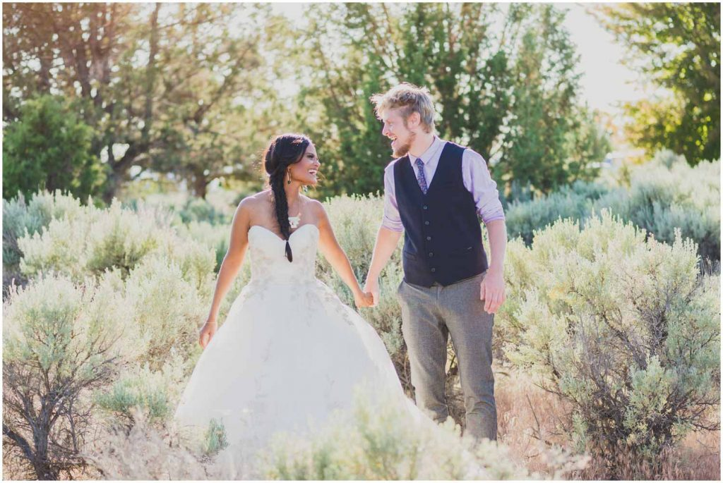 bride and groom laughing during golden hour in the sage outside ranch at the canyons