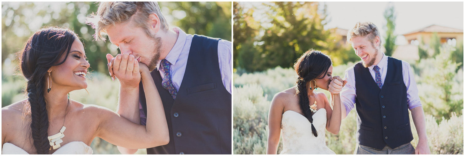 bride and groom laughing and kissing each other's hands after wedding golden hour